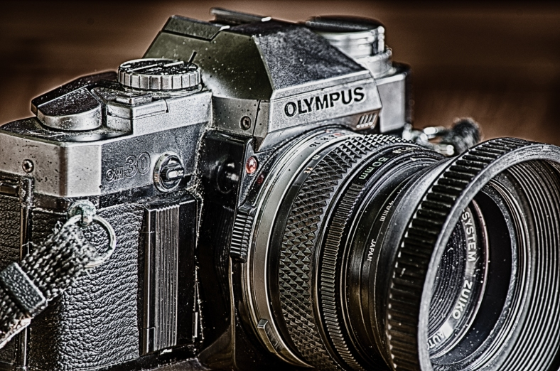 A close-up, HDR image of an old Olympus OM30 camera.
