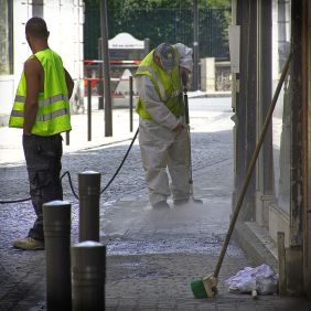 A color photographs of a street cleaner.