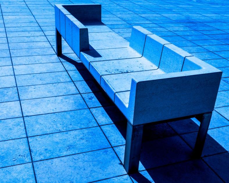Monochrome image of concrete seating.